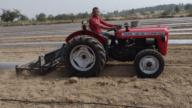 Kishore Kumar Deshmukh while mulching paper with the help of a tractor.