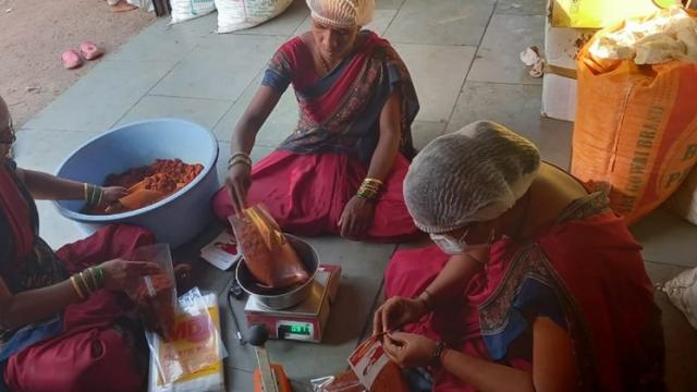 Women in the group while packing chutney masala