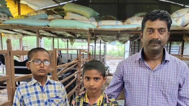 Jitendra Shelke with his children Rudra and Devendra. Arrangement for storing food on the back side of the shed.