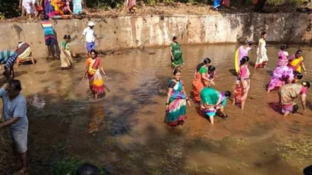 Villagers while cleaning the Bhairibhavani lake in the village