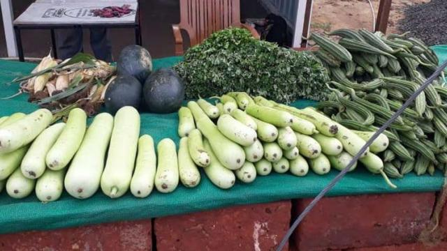 Vegetables are sold through stalls set up near the farm.