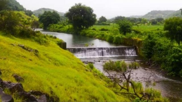 Cement dam on Chandni river flowing through the village.