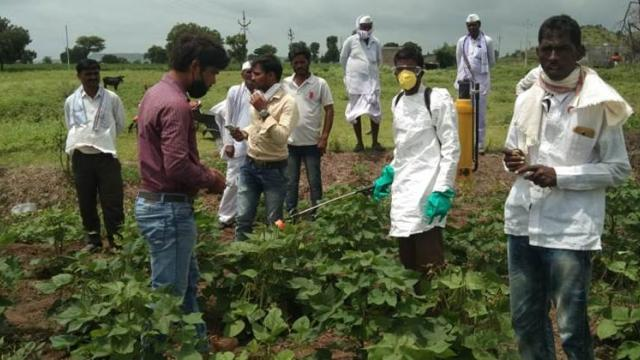 Farmers of Konewadi while learning pesticide spraying demonstration
