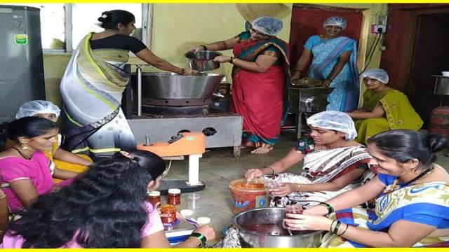 women's in self help group while processing the fruits