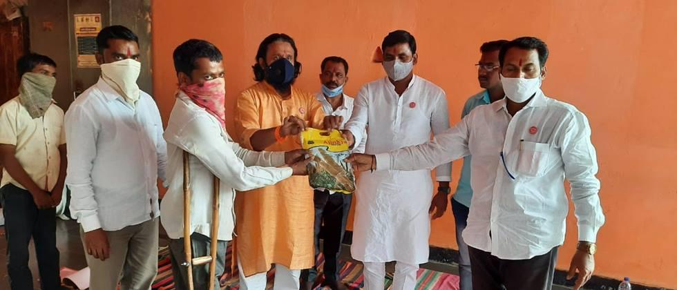 Distribution of kharif seeds to farmers by Swabhimani in Solapur district