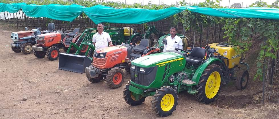 Patil brothers with farm machinery.