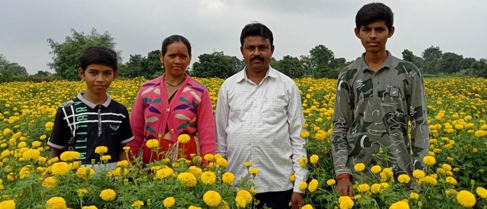 Mr. kate with his family in marigold flower plot