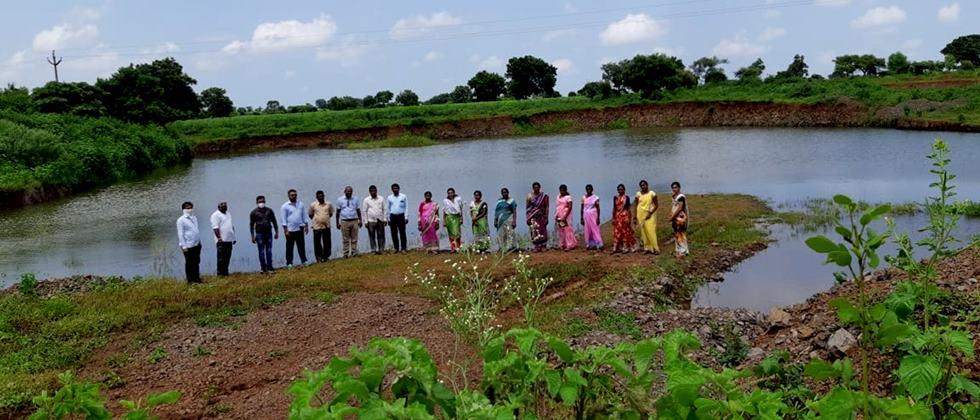 Citizens visit the village to see the water conservation work.