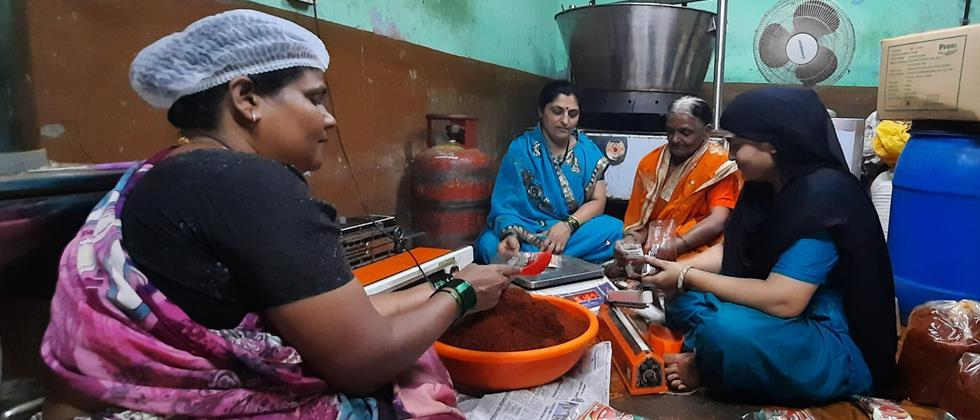 Shailja makes spices with the help of his mother and female colleagues.