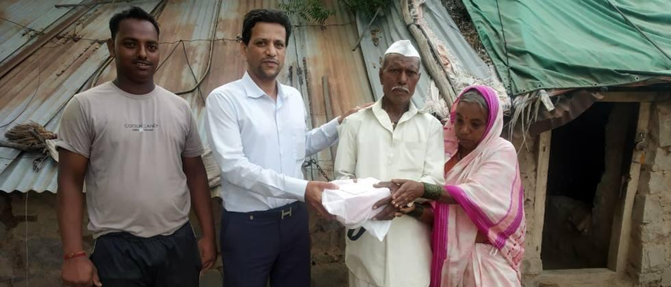 industrialist gives help to farmer