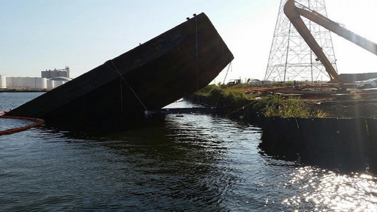 Two thousand tons of iron ore laden barge sank
