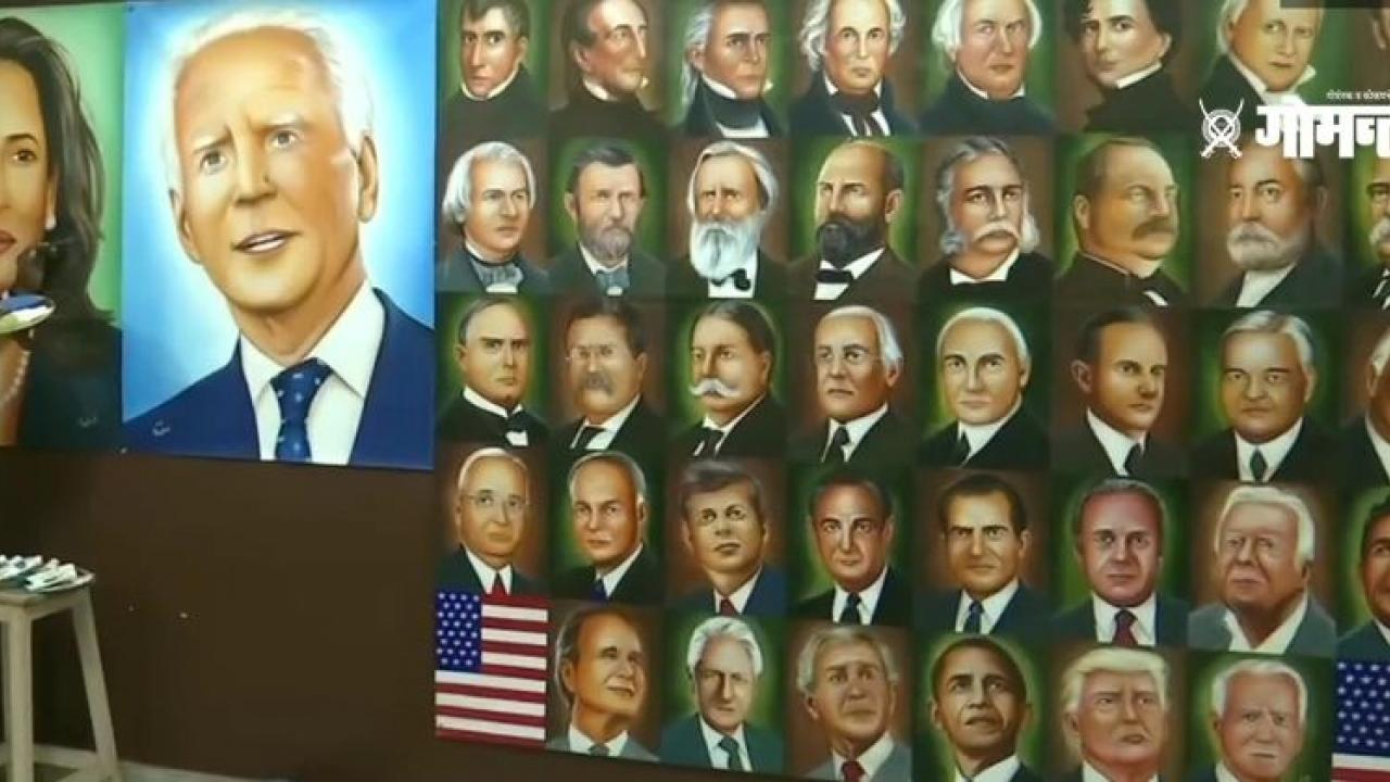 An artist from Amritsar paints a picture of US President Joe Biden and Vice President Kamala Harris