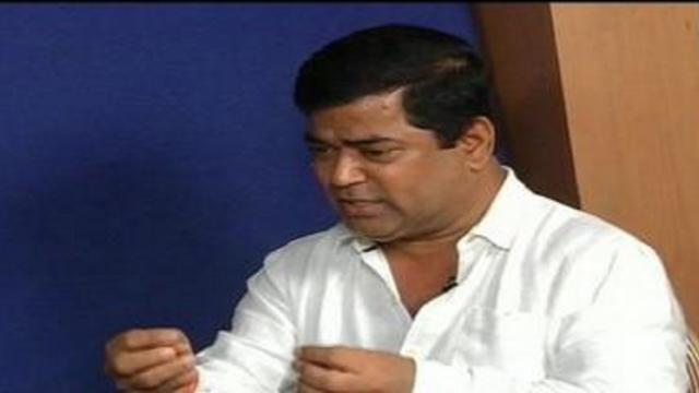 Why is there delay in action against deputy CM Chandrakant Kavalekar