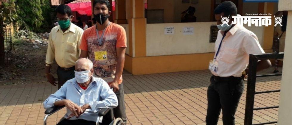 Goa Municipal Eletion 2021 Handicapped men voting in wheelchairs at Chawdi polling station