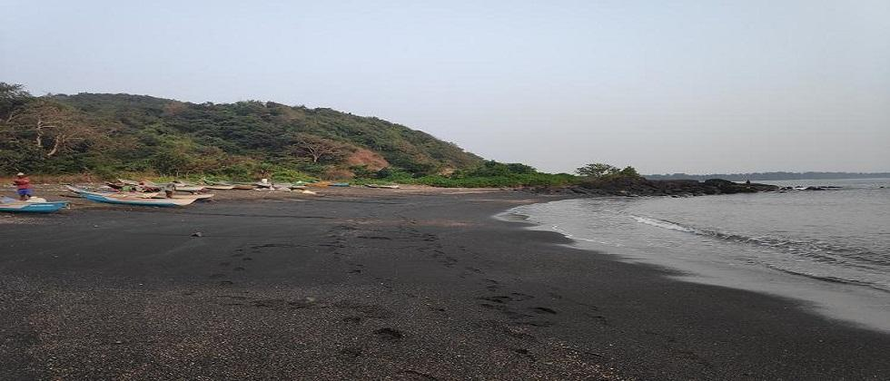 Small pieces of coal and oil were flowing come on shores of Karanjale