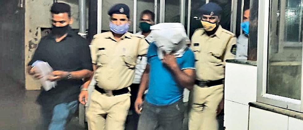 two arrested brought to Margaon police station in Swapnil Walke murder case