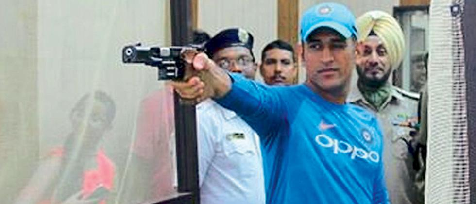 Mahendra Singh Dhoni practicing shooting during CSK training