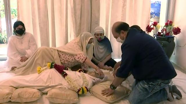 Maharashtra, July 07 (ANI): Wife Saira Bano and other relatives of actor Dilip Kumar sit near his mortal remains, at his residence, in Mumbai on Wednesday. (ANI Photo)