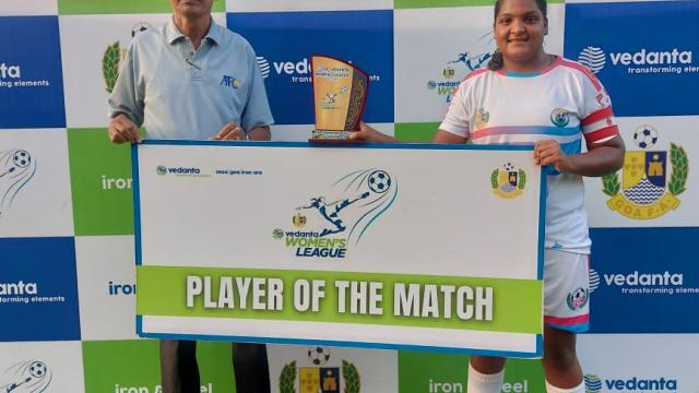 Nevilla Colaco(right) is given the player of the match award by Former international referee Milagres Tereza (left).