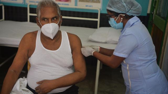 A healthcare worker inoculates a man with the first dose of the Covishield vaccine against the Covid-19 coronavirus at a free vaccination drive in Siliguri on June 23, 2021. (AFP)