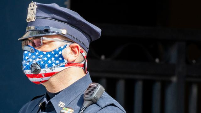 Representational image: Side angle of an NYPD Officer wearing a patriotic American Flag themed N95 Ventilator Mask while on duty in New York City during the difficult period of Coronavirus policing. (Unsplash)
