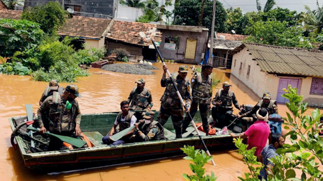 Indian Army personnel rescued stranded villagers from submerged areas following incessant rain in Bastwad, Karnataka and Kolhapur, Maharashtra on Sunday. (ANI)