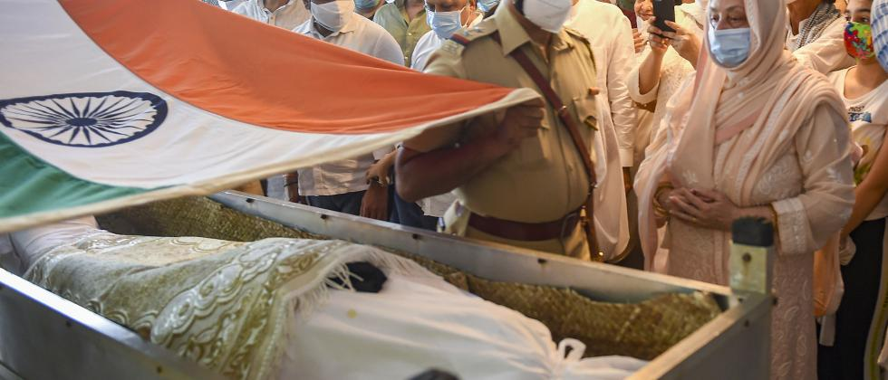 Mumbai: Police personnel wrap tricolor during the guard of honour to Bollywood legendary actor Dilip Kumar on his funeral, in Mumbai, Wednesday, July 7, 2021. Dilip Kumar passed away Wednesday morning at the age of 98 after a prolonged illness. (PTI Photo