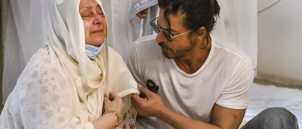 Mumbai: Bollywood actor Shahrukh Khan consoles legendary actor Dilip Kumar's wife Saira Banu on his demise, in Mumbai, Wednesday, July 7, 2021. Dilip Kumar passed away Wednesday morning at the age of 98 after a prolonged illness. (PTI Photo/Kunal Patil)