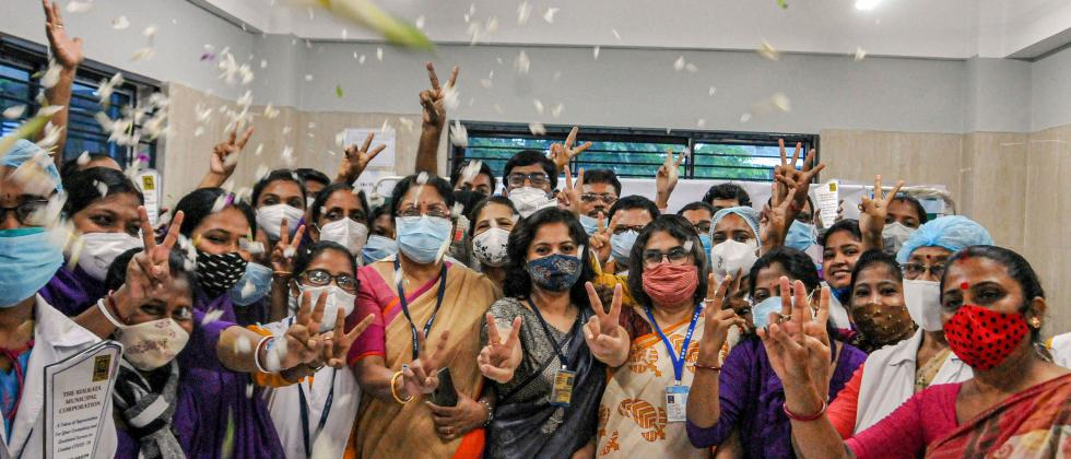 People showers flower petals to doctors, nurses and health workers as they participate in a thanksgiving felicitation programme on the occasion of National Doctor's Day, at Mayor's Health Clinic in Kolkata,Thursday, July 1, 2021. (PTI Photo)