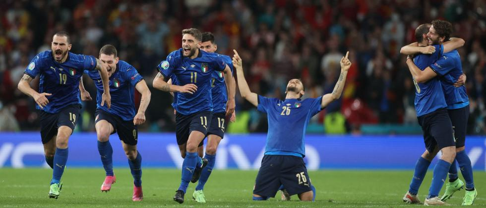 Italy's players celebrate after winning the UEFA EURO 2020 semi-final football match between Italy and Spain at Wembley Stadium in London on July 6, 2021. (AFP)