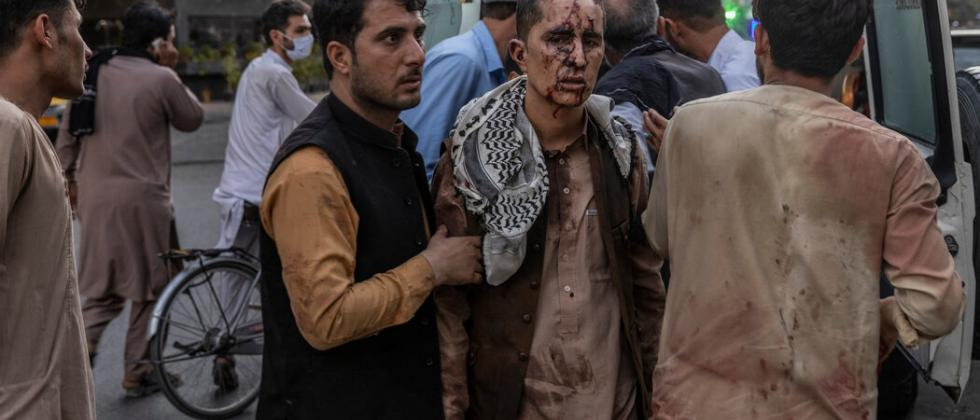 People injured in the two blasts at Kabul International airport (Photo courtsey - The New York Times)