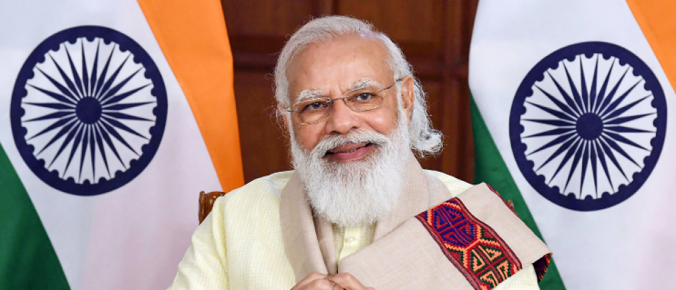Prime Minister Narendra Modi interacts with healthcare workers and beneficiaries of the COVID vaccination program in Goa, through video conferencing, in New Delhi.