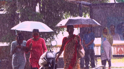 People take cover in Panjim as rain lashes Goa in August, 2021