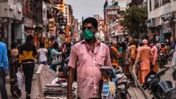 A man selling masks in the busy street of Varanasi during the pandemic.(Unsplash)