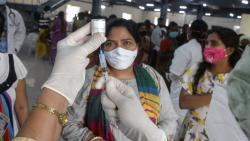 A health worker (R) prepares a syringe and needle with a dose of the Covaxin vaccine against the Covid-19 coronavirus during a vaccination drive at a multipurpose hall in Hyderabad on July 30, 2021. (AFP)