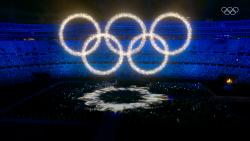 A display of luminous colours swirl together forms the Olympic Rings during the closing ceremony of the Tokyo Olympic 2020, in Tokyo on Sunday.