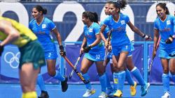 India's Gurjit Kaur (L) celebrates with teammates after scoring against Australia during their women's quarter-final match of the Tokyo 2020 Olympic Games field hockey competition, at the Oi Hockey Stadium in Tokyo, on August 2, 2021. (AFP)
