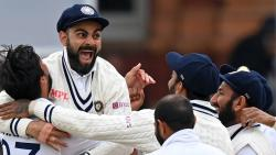 Virat Kohli (2L) celebrates with India's Ishant Sharma (L) and teammates after the successful appeal for the wicket of England's Jonny Bairstow on the fifth and final day of the second cricket Test match between England and India at Lord's cricket ground