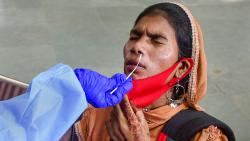 A BMC health worker collects swab samples of a passenger for COVID-19 testing at CSMT railway Station in Mumbai, Monday, Sept. 27, 2021