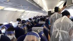 Passengers wearing face shield as they board a flight. Source: Twitter