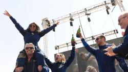 Virgin Galactic founder Sir Richard Branson (L), with Sirisha Bandla on his shoulders, cheers with crew members after flying into space aboard a Virgin Galactic vessel (AFP)