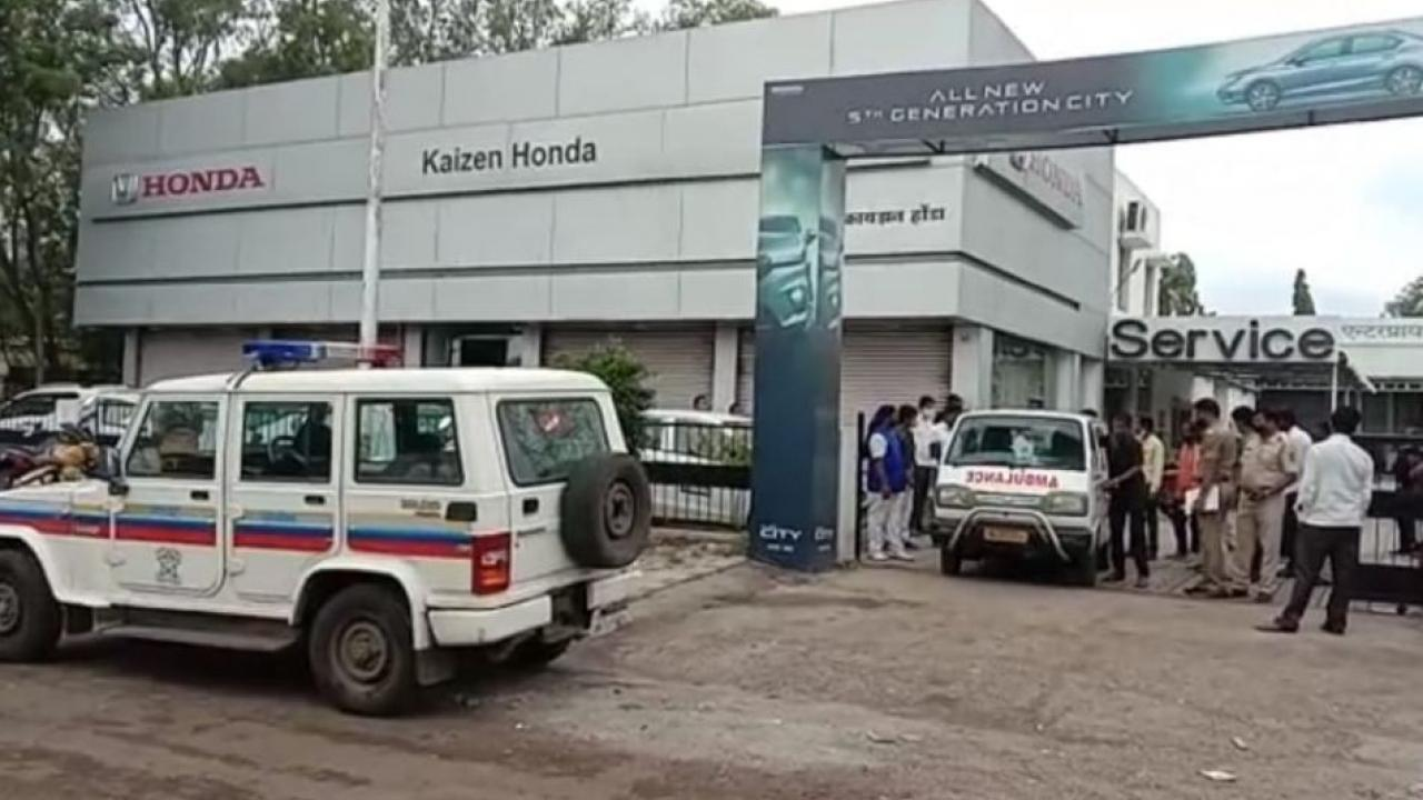 The dead body of a young man was found in a water tank in a Honda showroom
