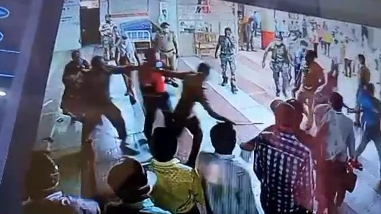 Youths fight with police at vaccination center