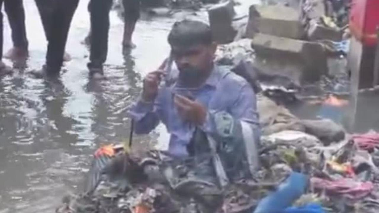 Bathing the contractor with the waste water from the nala