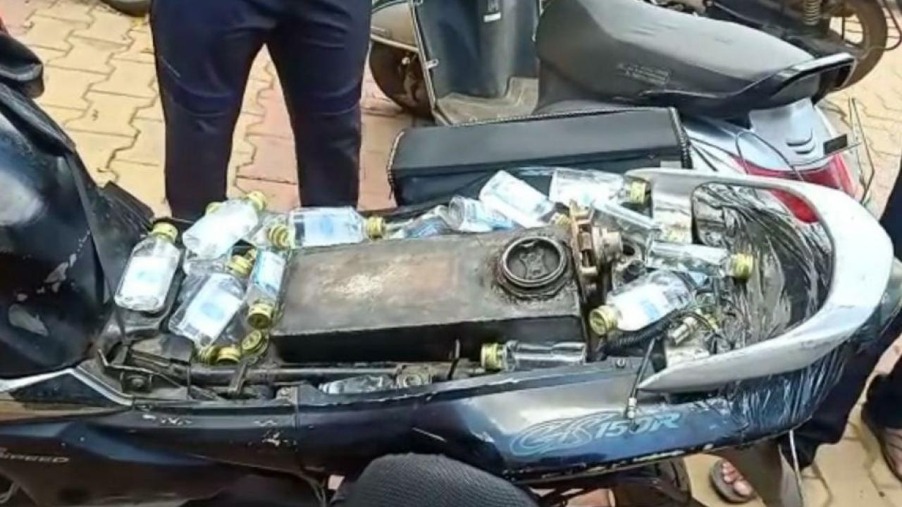 Smuggling of 500 bottles of liquor under the seat of two wheeler during lockdown period