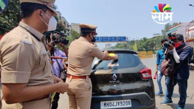 Mumbai Police Commissioner Hemant Nagrale Putting Sticker on Vehicle in Mumbai