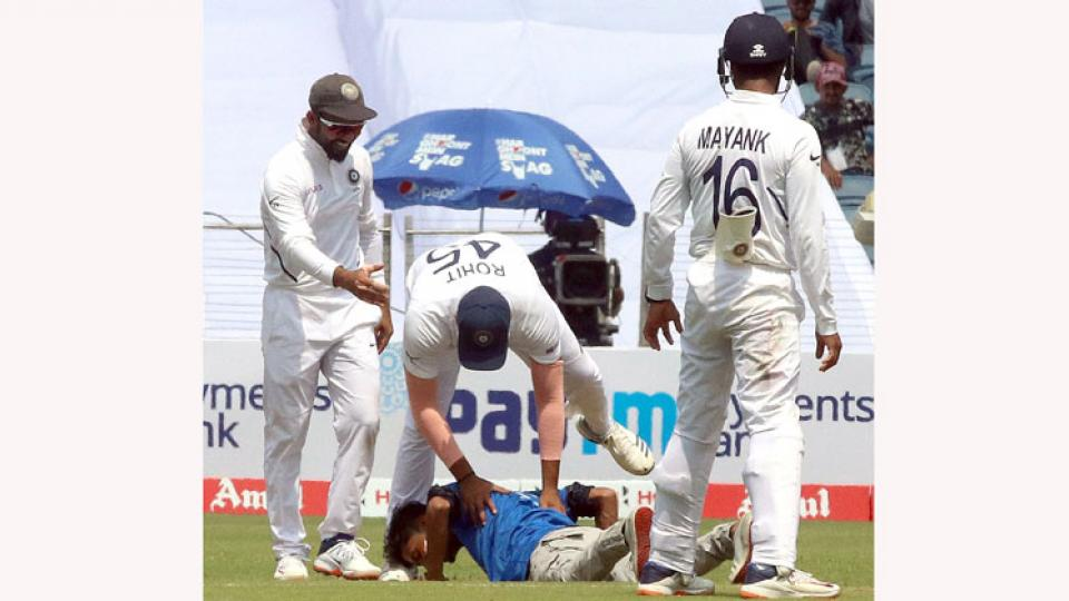 A fan breaches security to meet Rohit Sharma in test against South Africa