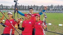 (left to right) Divya Dhayal, Sanchita Tiwari and Khushbu Dhayal. Also seen in the picture is their coach  Lt. Col Vikram Dhayal.