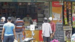 Residents keep distance as local markets open