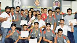 All the winners pose with their medals at the conclusion District-Level Powerlifting championship at NMV Prashala here on Monday.